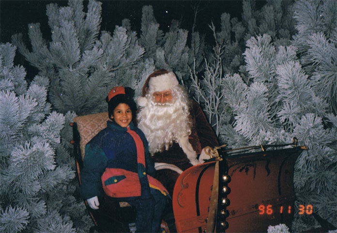 Jordyn with Santa Claus at Prairie Pines Christmas Tree Farm